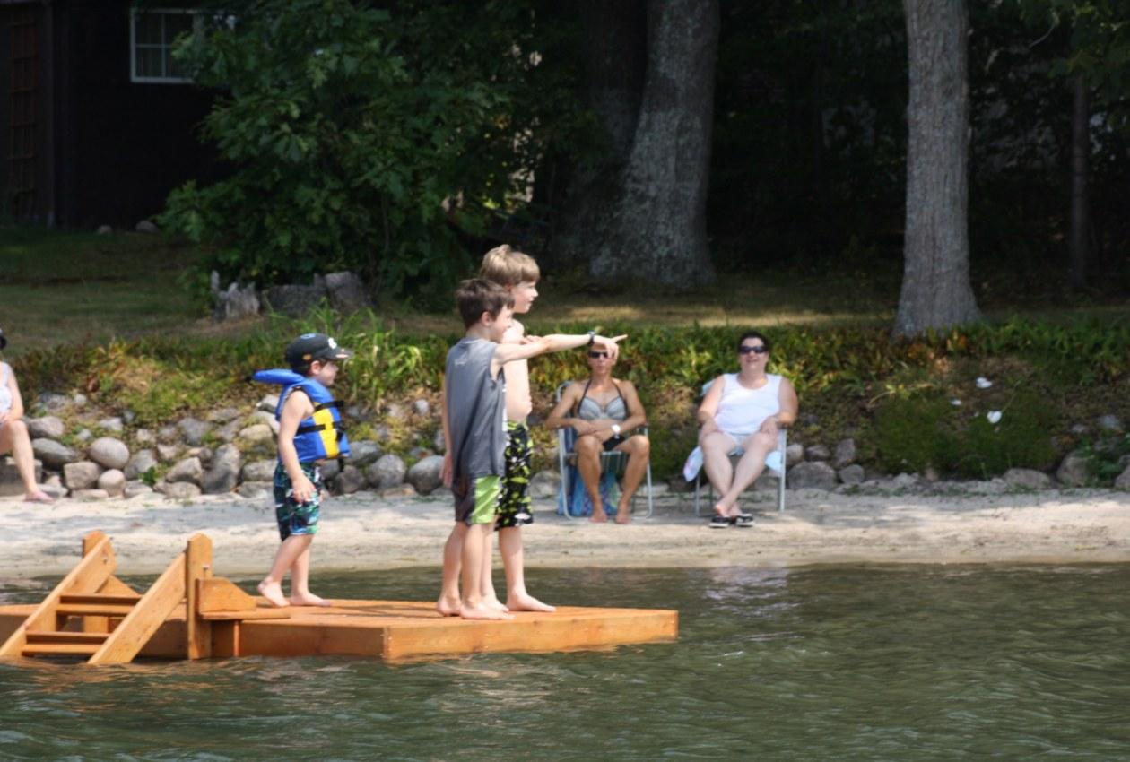 Kids on floating raft